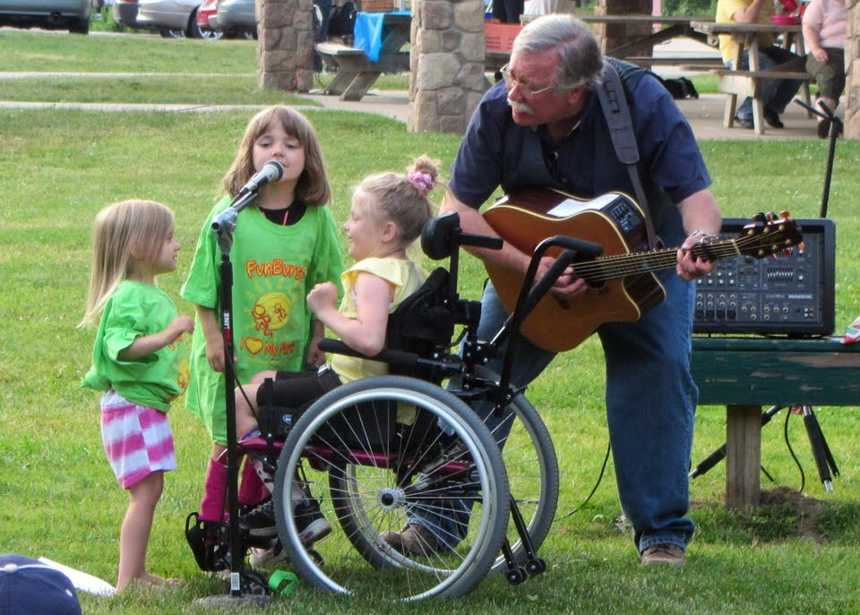 A group of girls joined in on one of the songs at the Oshtemo Library Summer Reading Kickoff.